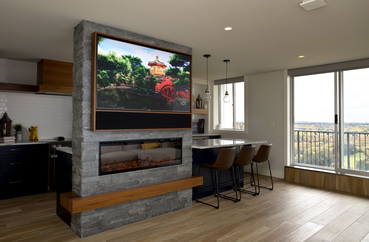 A condo living room with a Leon Media Edge with Horizon soundbar. The motorized shades are by Lutron.